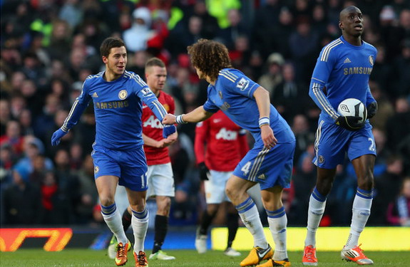 Eden Hazard celebrates after scoring against Manchester United with Chelsea teammate David Luiz