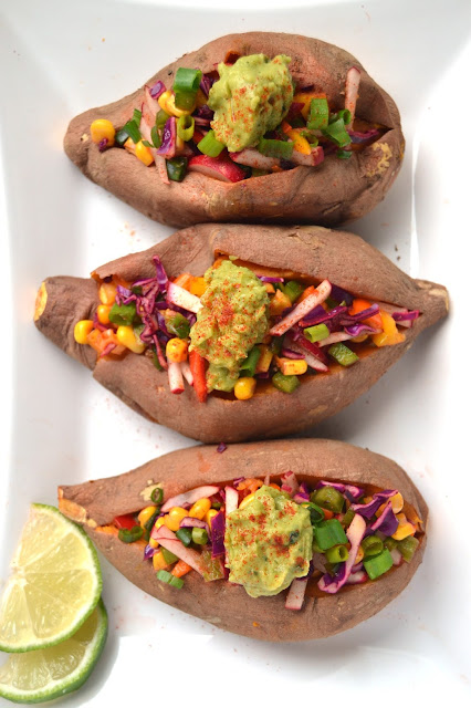 These chipotle stuffed sweet potatoes are fresh and full of flavor! They are packed full of vegetables for a delicious and nutritious side dish. www.nutritionistreviews.com