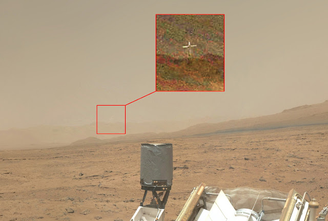 http://silentobserver68.blogspot.com/2012/11/mysterious-cross-on-mars-video.html