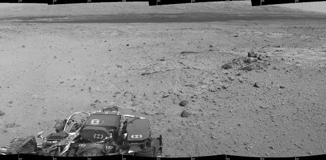 This mosaic of images from the Navigation Camera (Navcam) on NASA's Mars rover Curiosity shows the scene from the rover's position on the 376th Martian day, or sol, of the mission (Aug. 27, 2013). The images were taken right after Curiosity completed the first drive during which it used autonomous navigation on unknown ground. Credit: NASA/JPL-Caltech