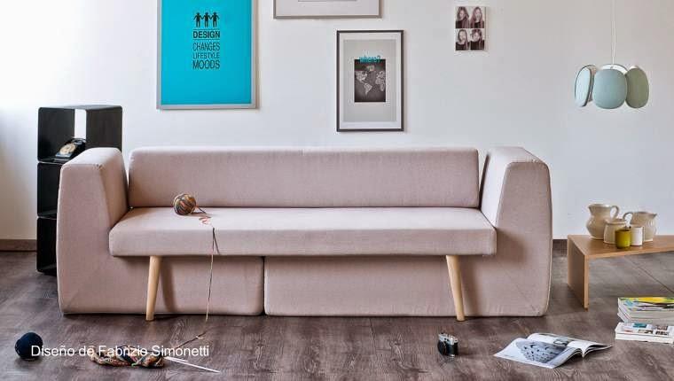 Moderno sofá modular de tres partes tapizado en un tono claro