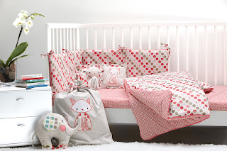 Ella & Otto Cot/Cot Bed Bumper & Sheet Set, Quilt, Cat cushion and Cat Laundry Bag. Shown on a cot.