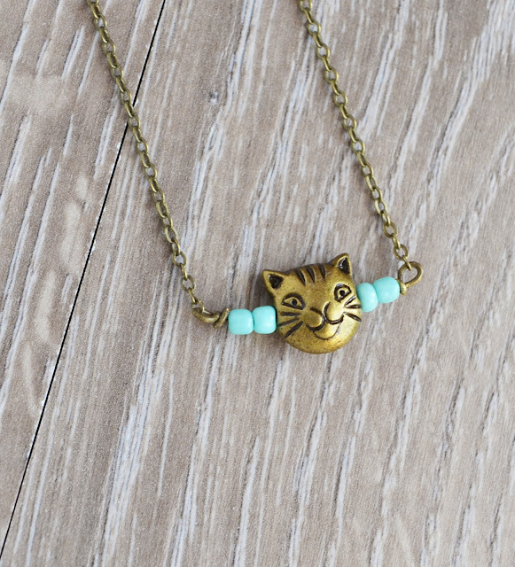 https://www.etsy.com/listing/110357927/kitty-cat-necklace-cat-jewelry-crazy-cat?ref=shop_home_active