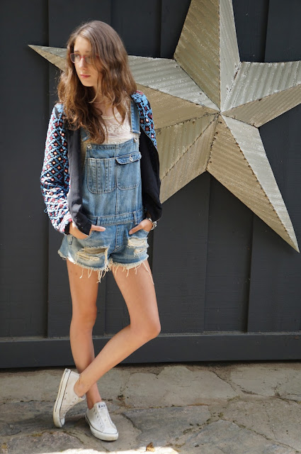 Zara embellished bomber jacket, denim overalls, lace tee shirt, white chuck taylor converse
