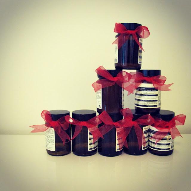 (Lights and Reds} Red ribbon bows around aesop jars on petiteplayground.blogspot.com