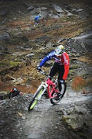 fot van fietser bovenop een berg