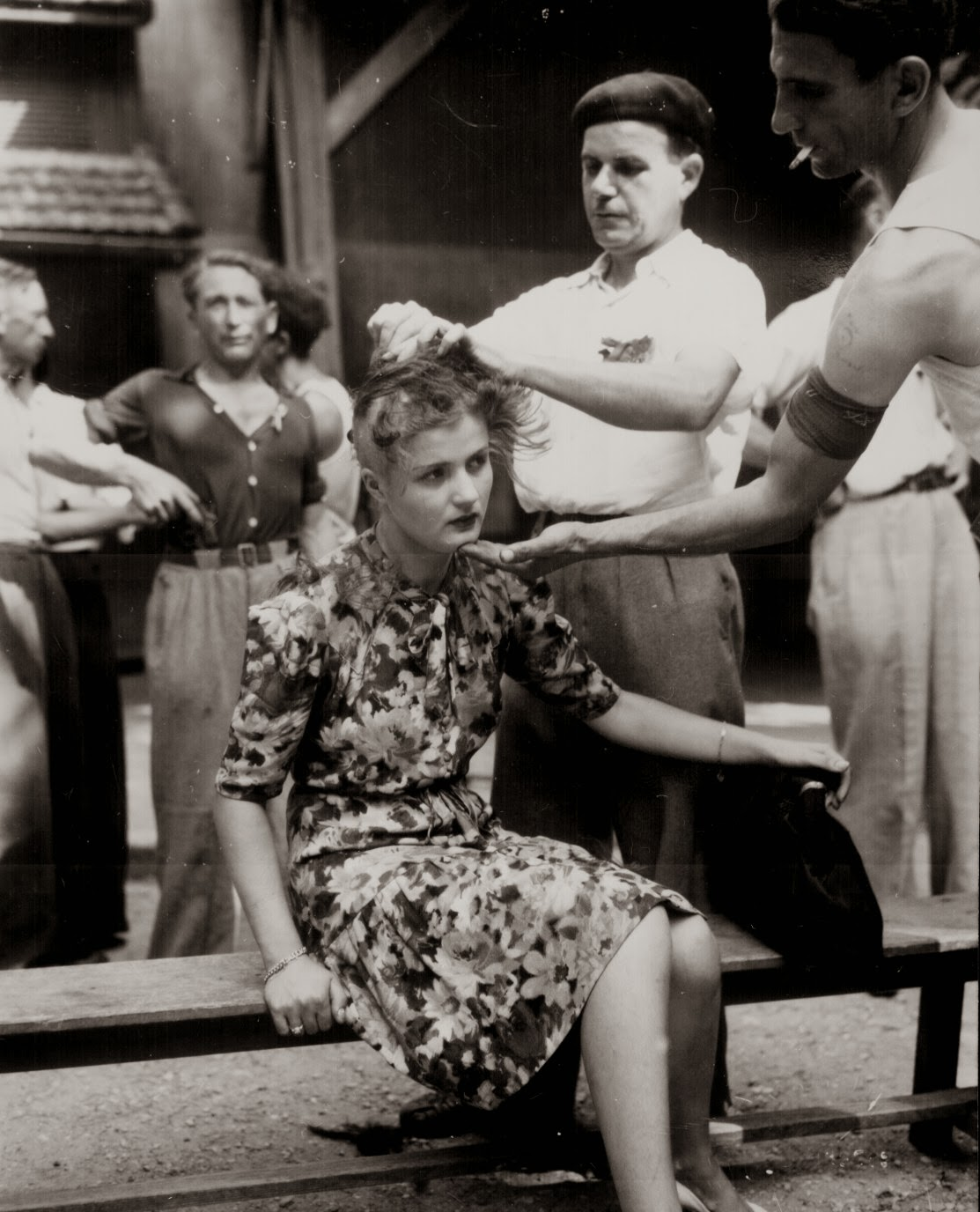 Woman being shaved by civilians to publicly mark her as a collaborator, 1944