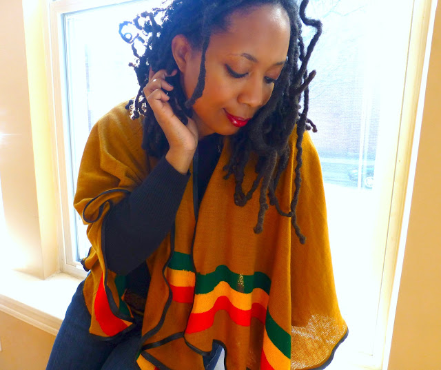 rasta colors dreadlocked woman