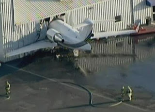 A Canadair Bombardier Challenger crashes into airport hangar