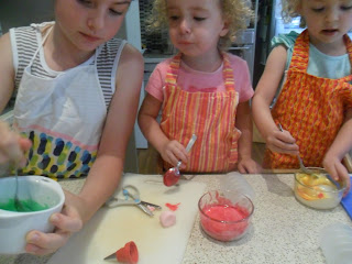 Colouring icing to decorate biscuits.