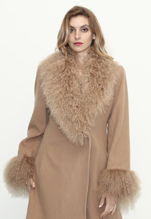 Vintage 1970's camel colored wool coat with Mongolian lamb fur collar and cuffs.