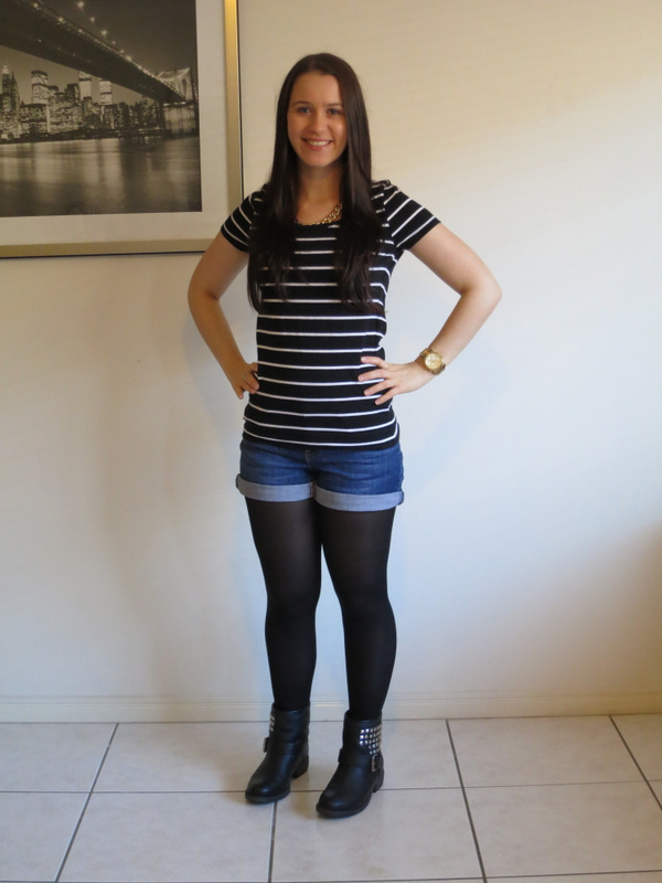 Dark was denim shorts with black tights, striped t-shirt and leather & military jacket, with leather boots and gold jewellery