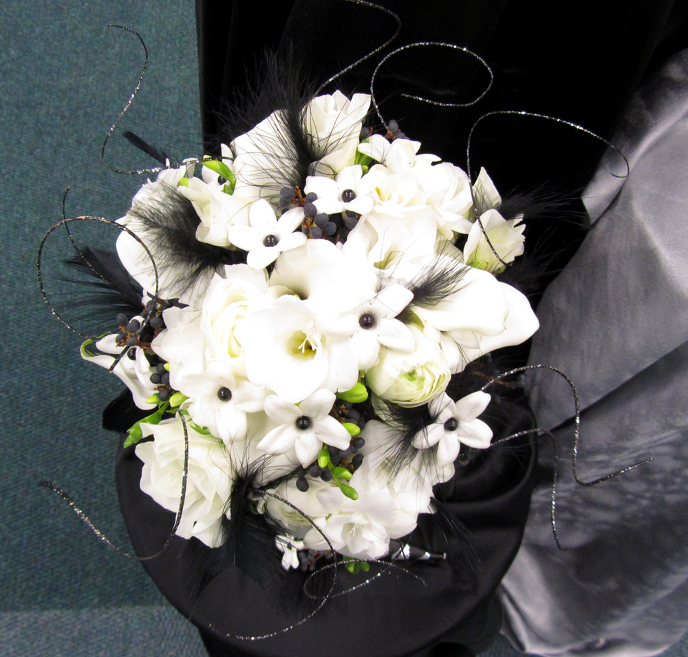 Dodge the florist for a black and white wedding theme you can do one of two things add an accent color for the flowers to give a nice pop of contrast or incorporate izmirmasajfo Images