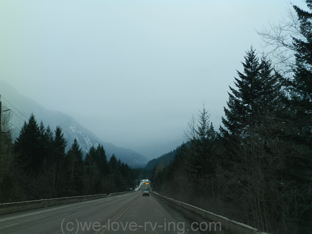 The road ahead looks good but the clouds are dark with pending snow.