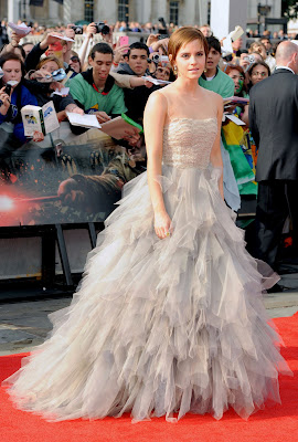 Emma Watson the harry potter girl look nice with gown on premier of Harry potter and the deathly hallows part 2