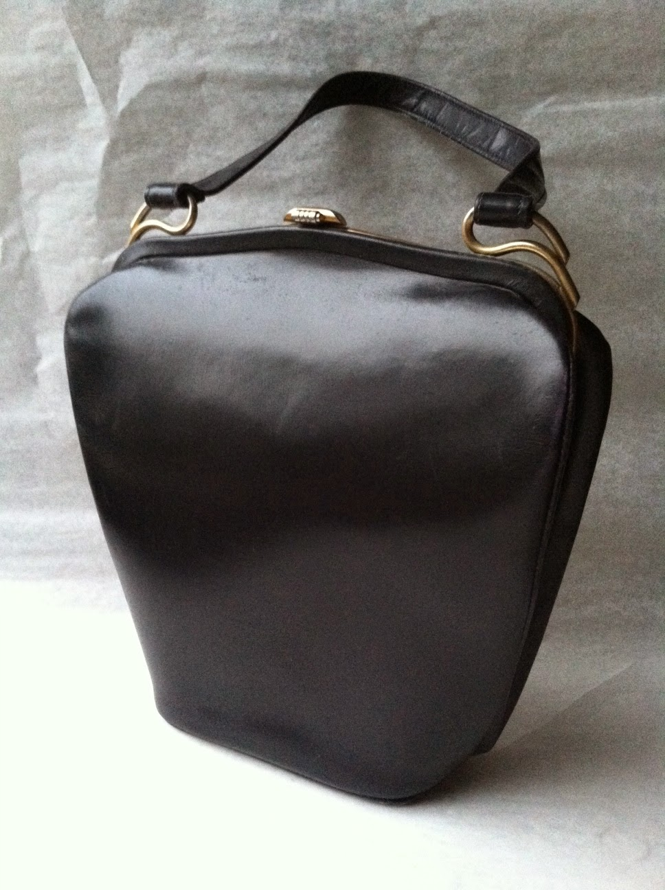 https://www.zibbet.com/second-story/black-leather-dofan-evening-bag