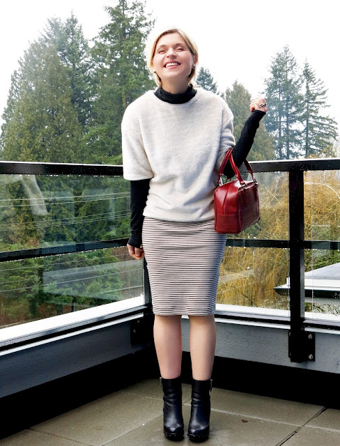 styling a turtleneck under a plush tee, with a striped pencil skirt and platform booties