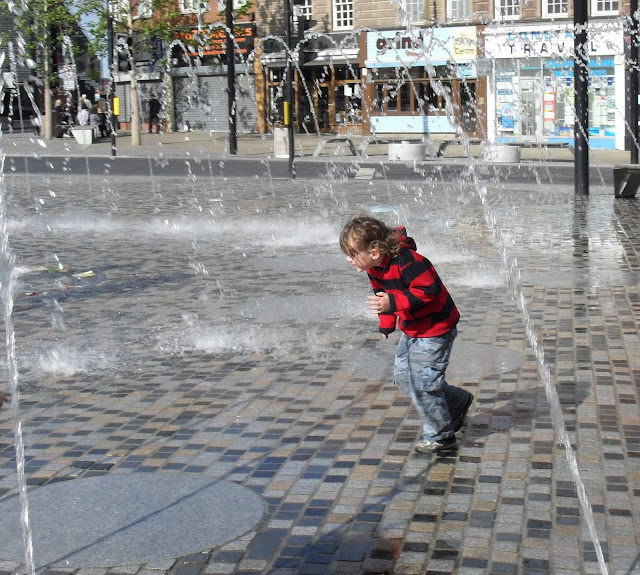 The Boy running through a fountain