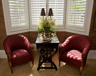 window shutters accent bay window in living room