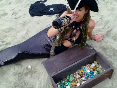 mermaid shelly drinking rum as a mermaid pirate by vintagemermaidsociety.blogspotcom