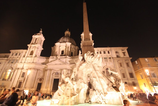 Four Rivers fountain and Sant'Agnese in Agone at the background at Piazza Navona in Rome, Italy