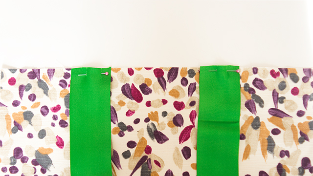 ribbon handles pinned to bag