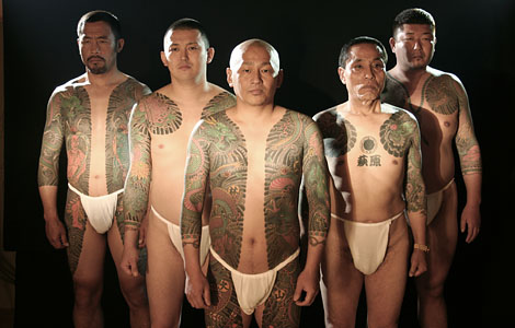 chinese men with Moari tattoo