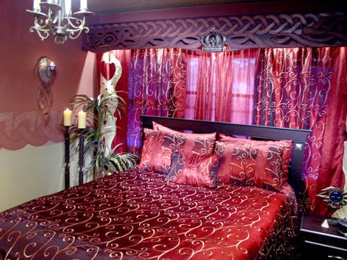 luxurious romantic bedroom with red curtains