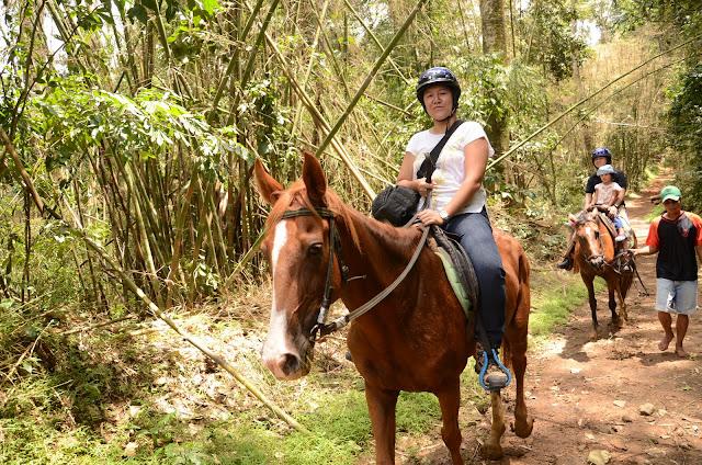 Mama on horseback, followed by Daddy & Kecil