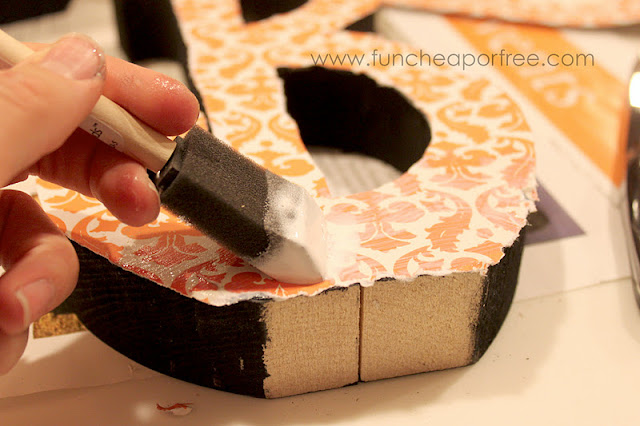 Putting Mod Podge on top of paper, from Fun Cheap or Free