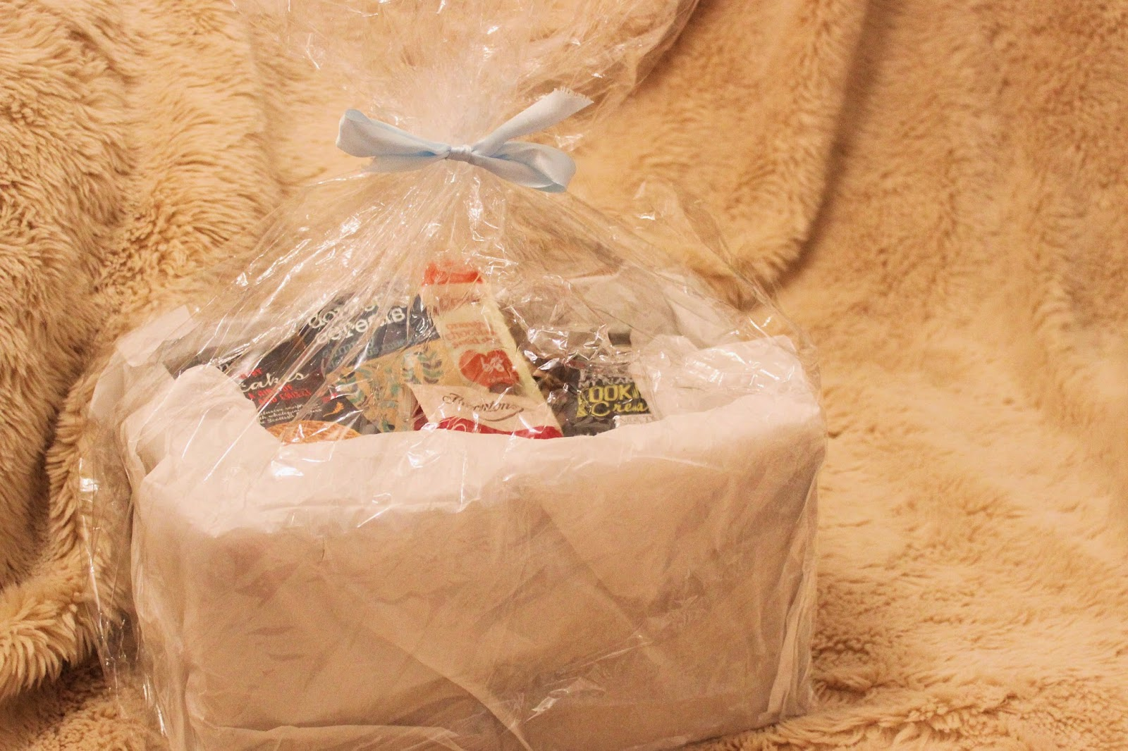 complete luxury food hamper in cellophane wrap with bow