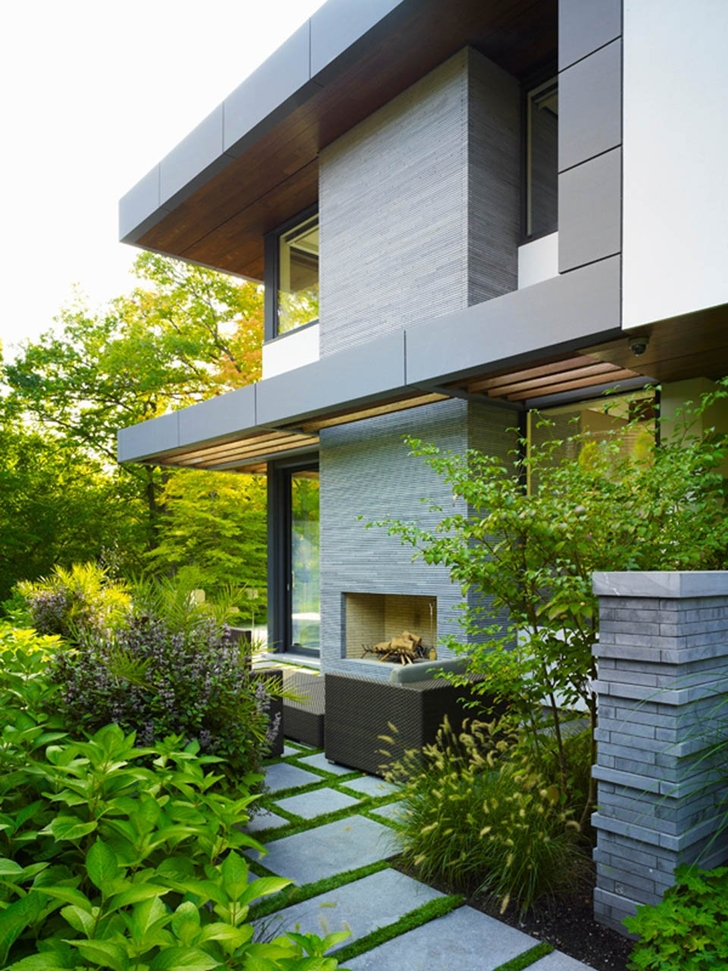 Outdoor fireplace in the Modern mansion by Belzberg Architects Group