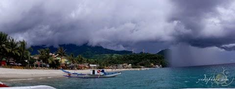 Rain approaching the coastline in White Beach Puerto Galera.