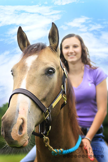 Hendersonville, NC senior girl sitting on horse in senior pictures.