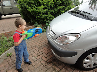 Big Boy Washing the Car with a Water Gun