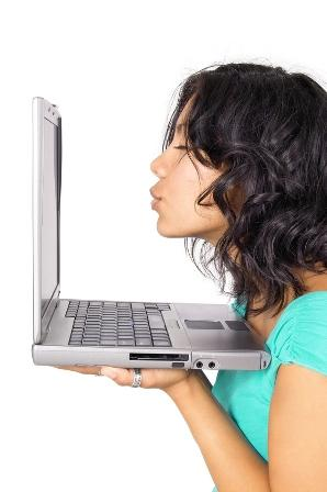 5 Ways to Master Online Dating - girl kissing laptop computer