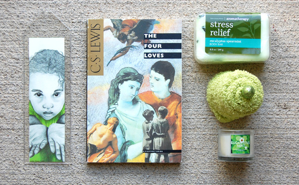 Green Gilr 2 bookmark from The True Colors Collection, The Four Loves by C.S. Lewis, stress relief soap and eucalyptus candle, both from Bath and Body works.