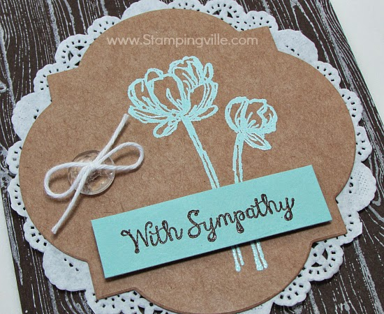 Close-up image of Bloom With Hope Sympathy Card heat embossed flower and sentiment.