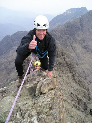 Kendal Mountaineering Services clients rock climbing on the Inaccessible Pinnacle, Cuillin Ridge, Isle of Skye