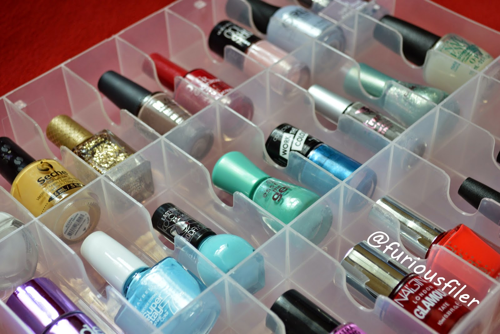 A couple of weeks ago I finally accepted that I needed to reorganize my nail polish stash. I use 2 Melmers and a DIY nail polish rack to store my polish and it is a wonderful system if I actually use it! I made the terrible mistake of reorganizing my stash by brand (instead of color).
