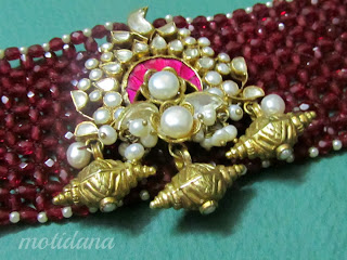 right angle weave beadwork , ruby beads