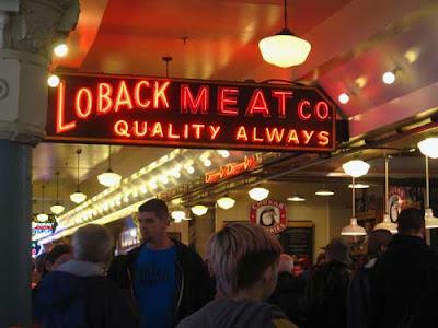 Glowing orange neon light reading Loback's Meats