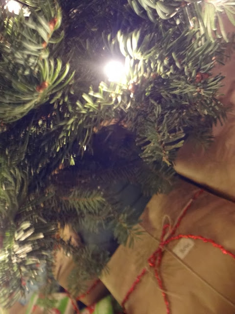 Presents under a tree, wrapped in brown parcel paper