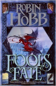 cover art for Fool's Fate, featuring a black dragon and a red dragon battling on the edge of a glacier. The main illustration is bordered in blue with smaller portraits at each corner.