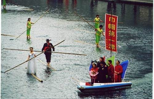 Crossing the river with a bamboo China