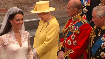 Catherine smiles after saluting the Queen. YouTube 2011.