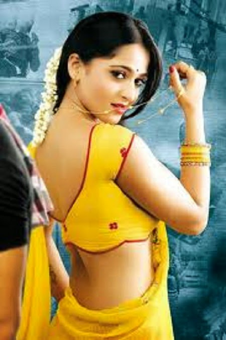 Beautiful girl in yellow saree