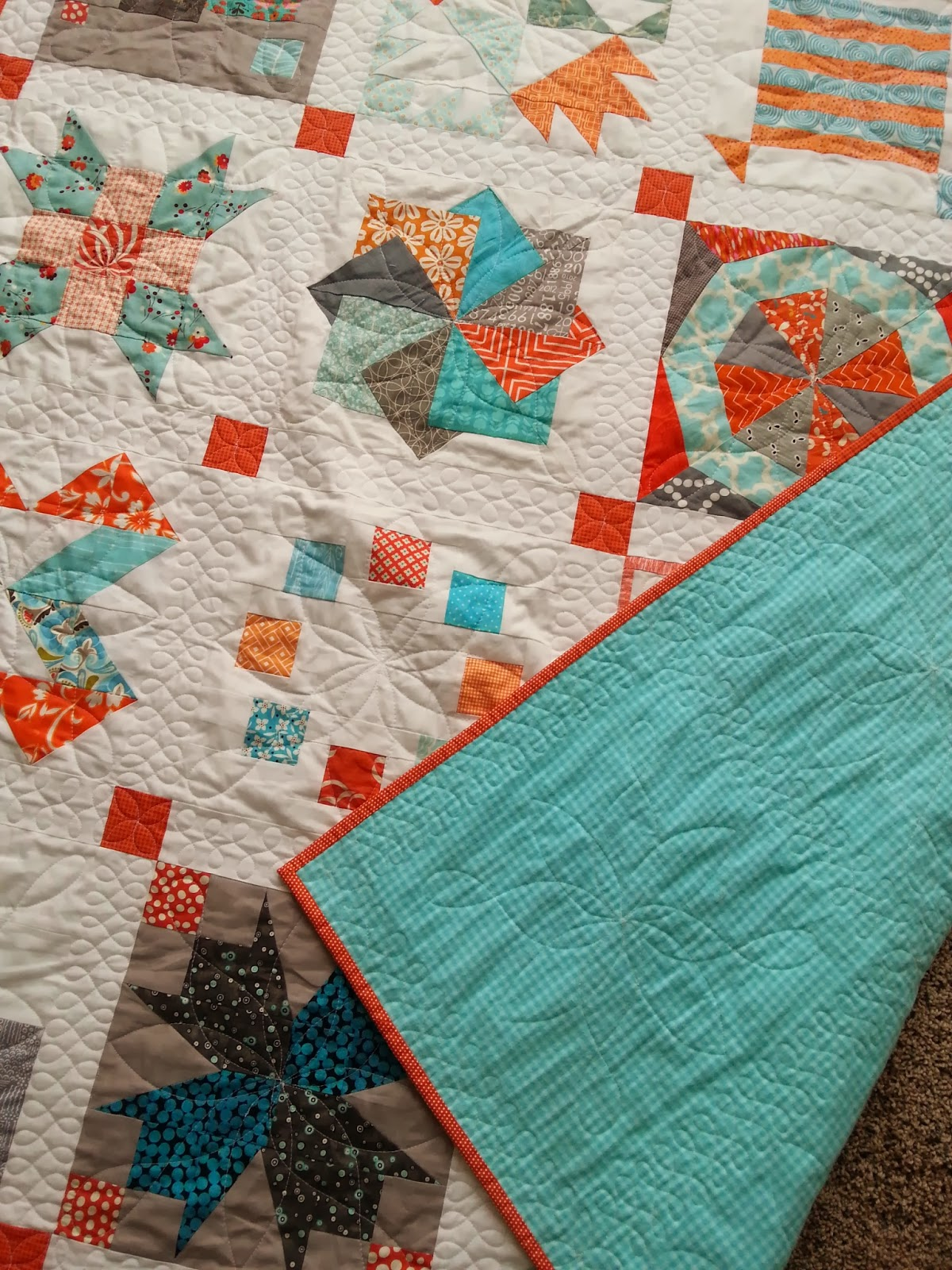 Aqua and Orange Sampler Quilt Finish
