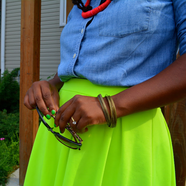 neon skirt worn with denim shirt