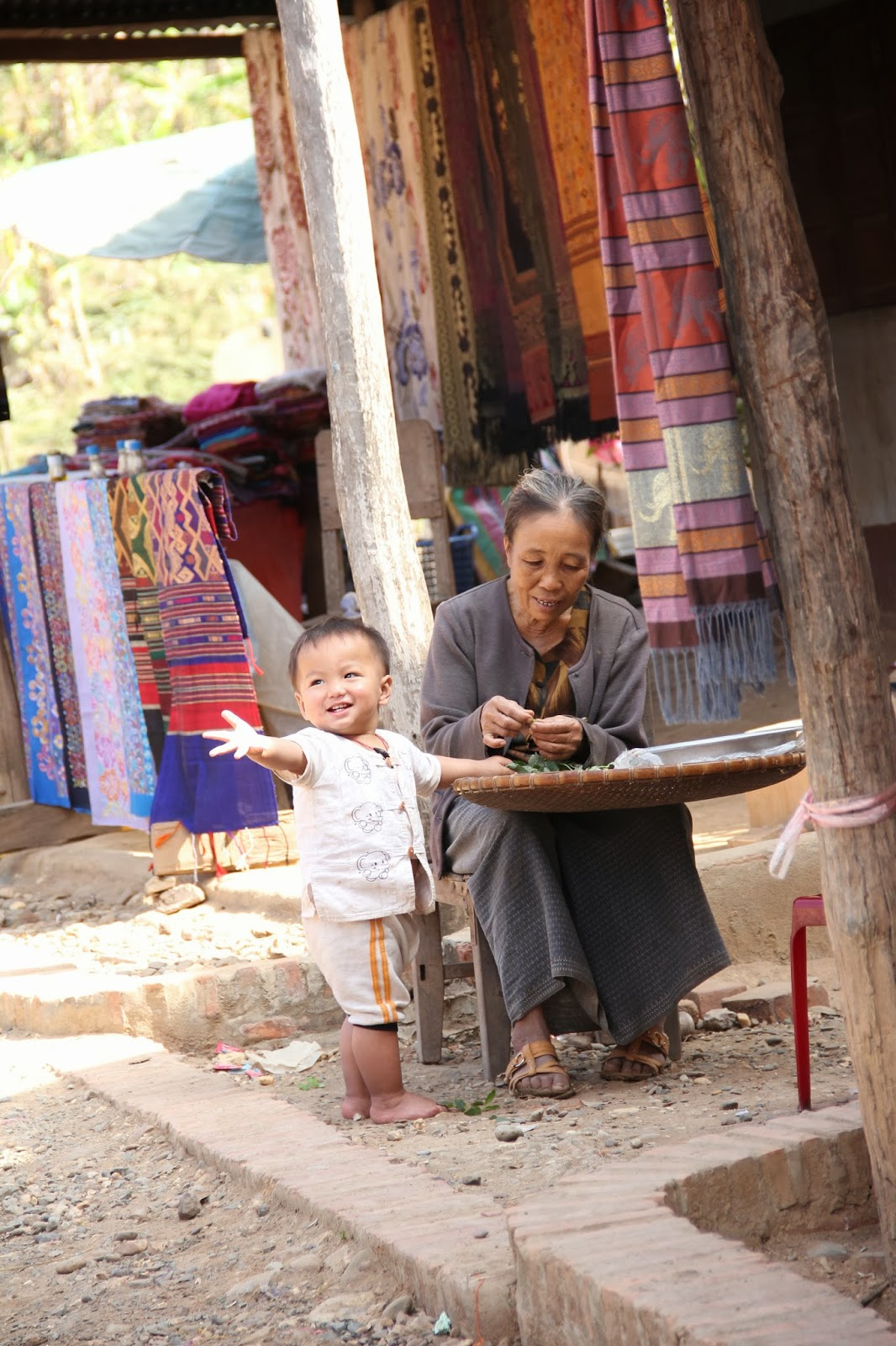 Local woman and child in Baan Xang Hai village